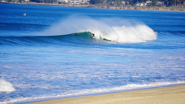 Surfer in the waves, Half Moon Bay, CA