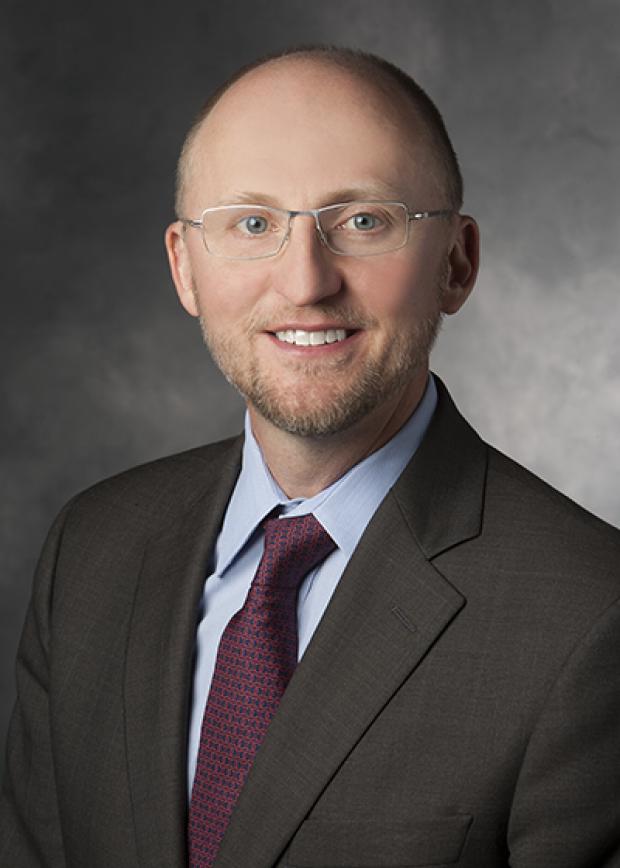 Dr. Christopher Holsinger