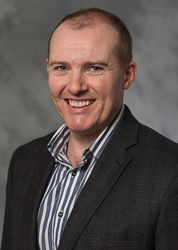 Dr. Dáibhid Ó Maoiléidigh, PhD
