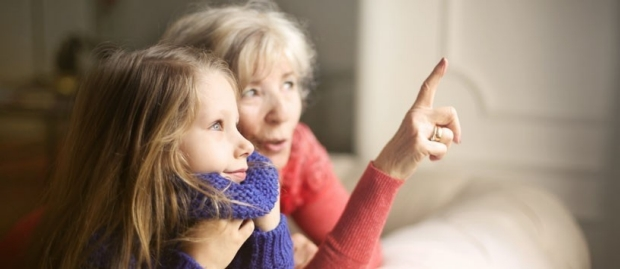 Grandmother pointing out something to grandchild