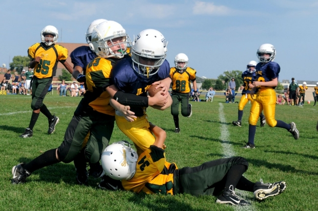 football players tackle during game