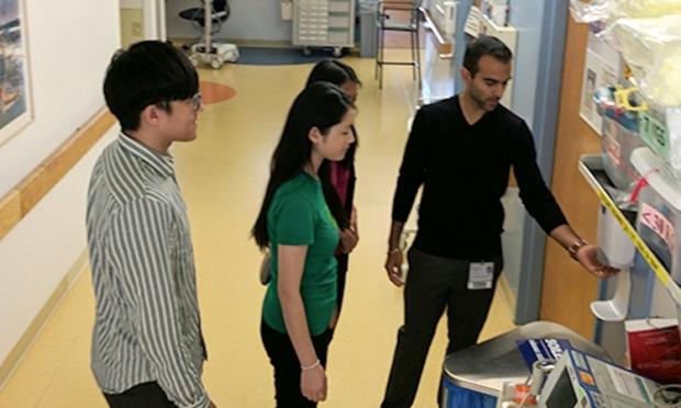 Researchers testing hand sanitizer dispenser