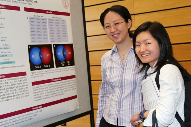 Physician scientists viewing presentation