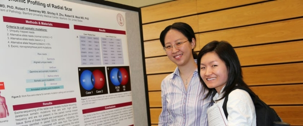 Physician scientists viewing a presentation