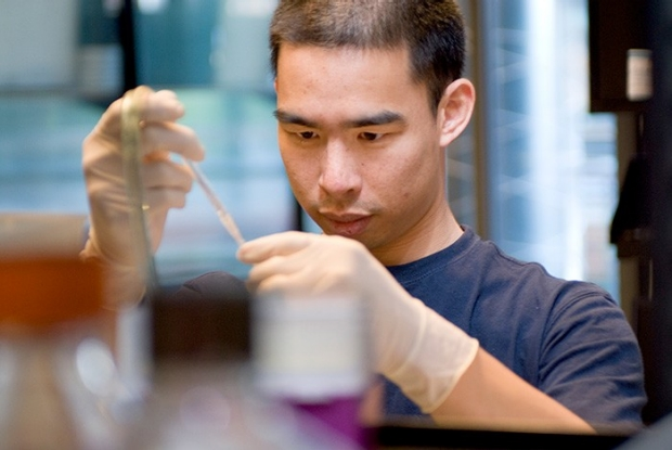 Explore Research Labs: researcher using dropper