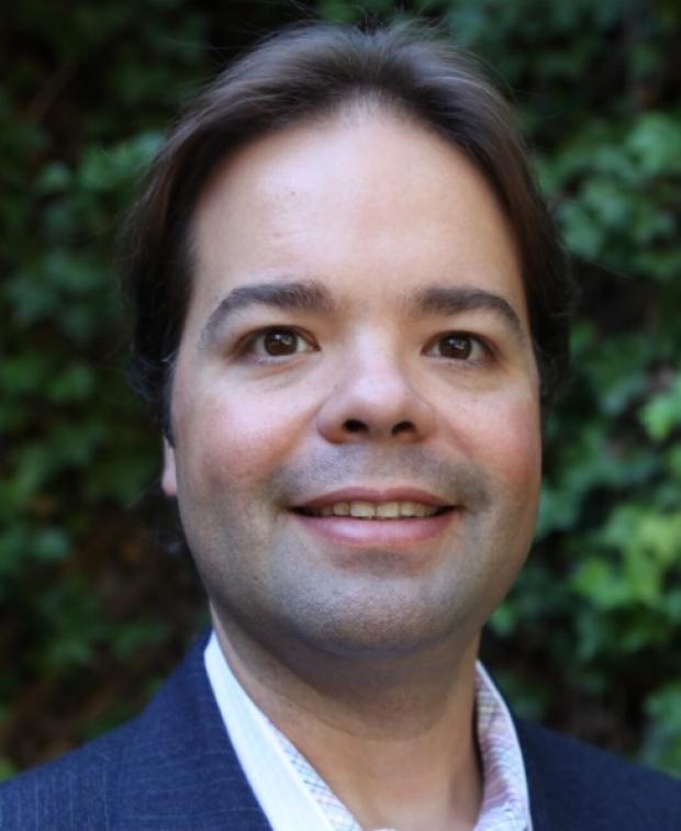Photo of Dr. Carlos Bustamante, Ph.D., M.S.