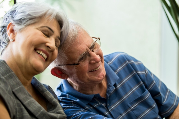 elderly couple laughing