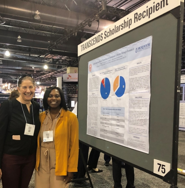 Dr. Kathleen Poston at AAN TRANSCENDS mentee Dr. Chantale Branson's research presentation at the 2019 AAN