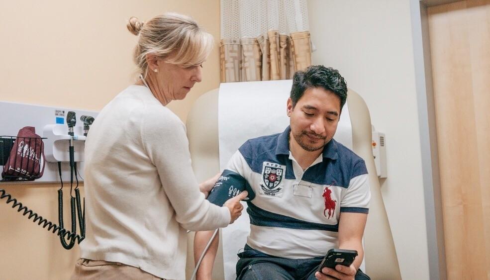 patient getting blood pressure test