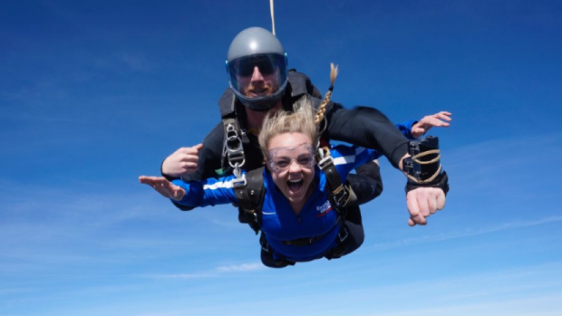 Stoked-Graduate-Lexi-Long-explores-happiness-from-10-000-ft
