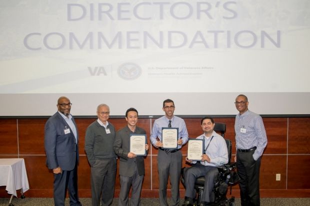Photo of Bao Do, Josh Reicher and Payam Massaband receiving the Director's Commendation for UNITY