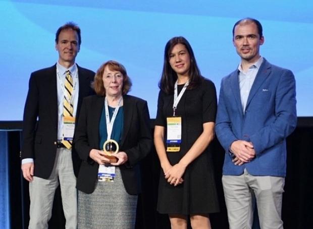 Photo of Katherine Ferrara receiving 2019 WMIS Gold Medal Award