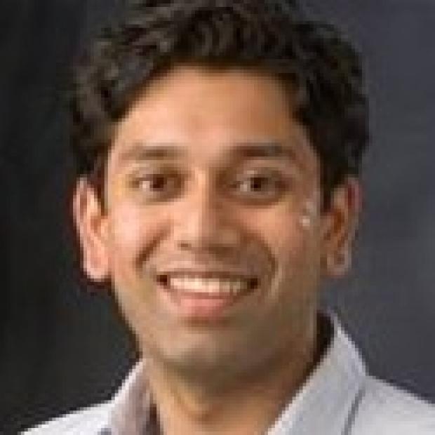 smiling headshot of Ravi Karra