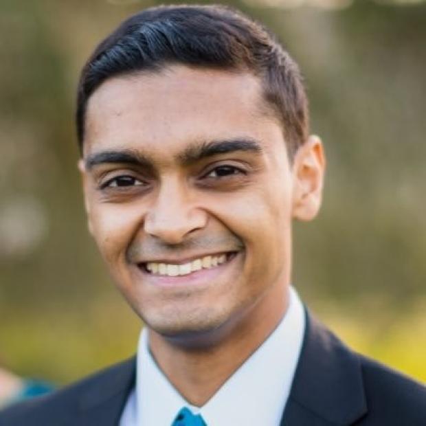 smiling headshot of Arun Sharma
