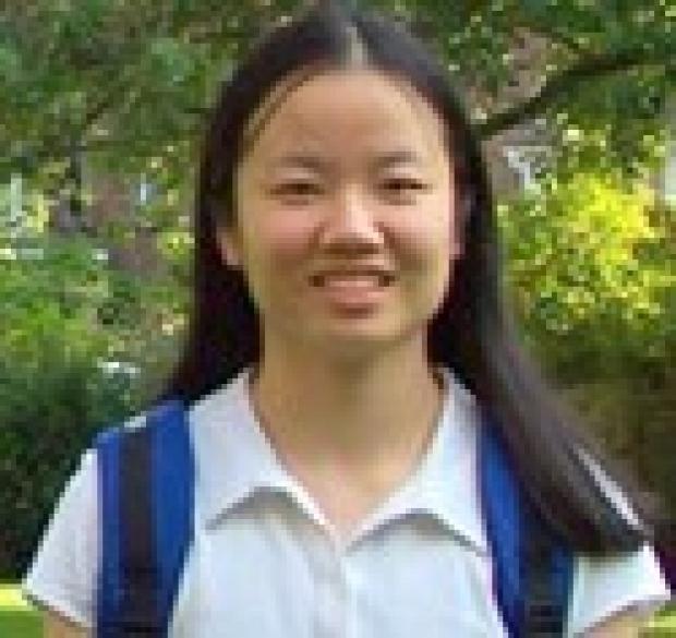 smiling headshot of Xiaojing Huang