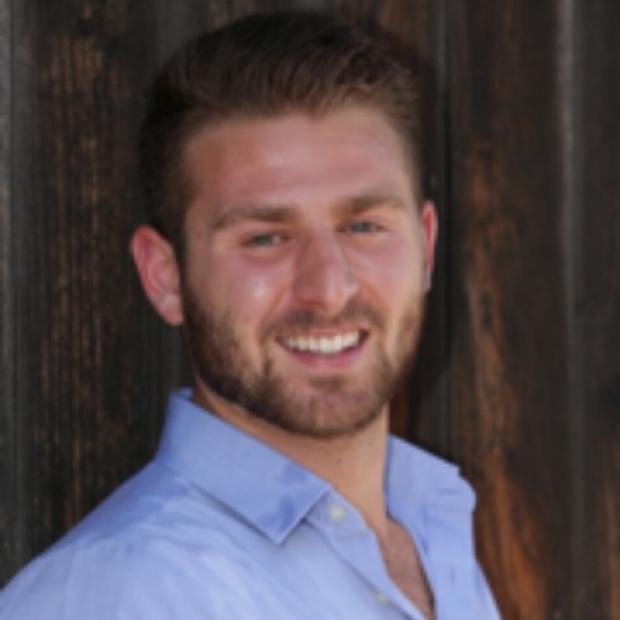 smiling headshot of Orlando Chirikian