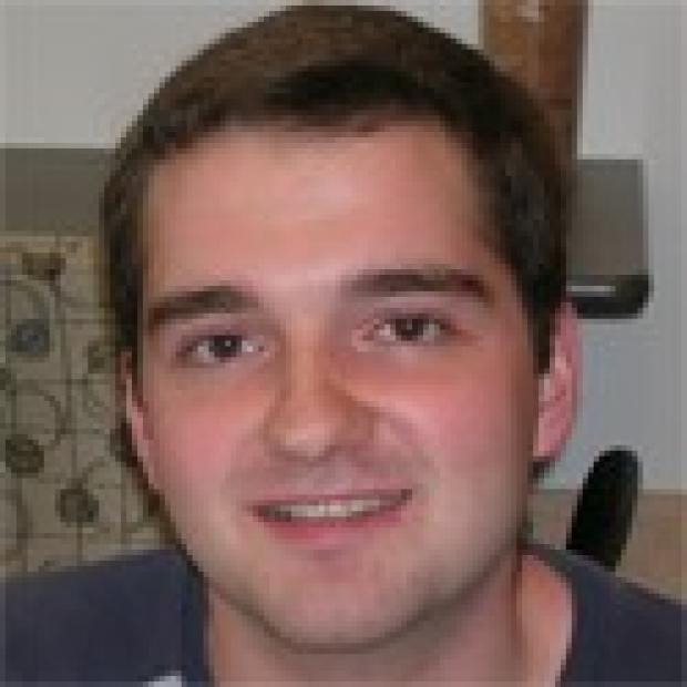 smiling headshot of David Rawnsley