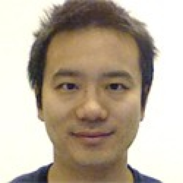 smiling headshot of Wenpo Chuang