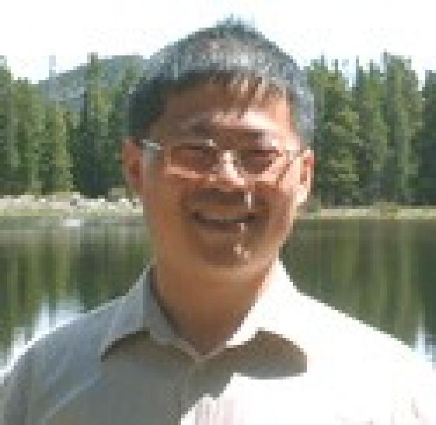 smiling headshot of Yuan-Hung Liu