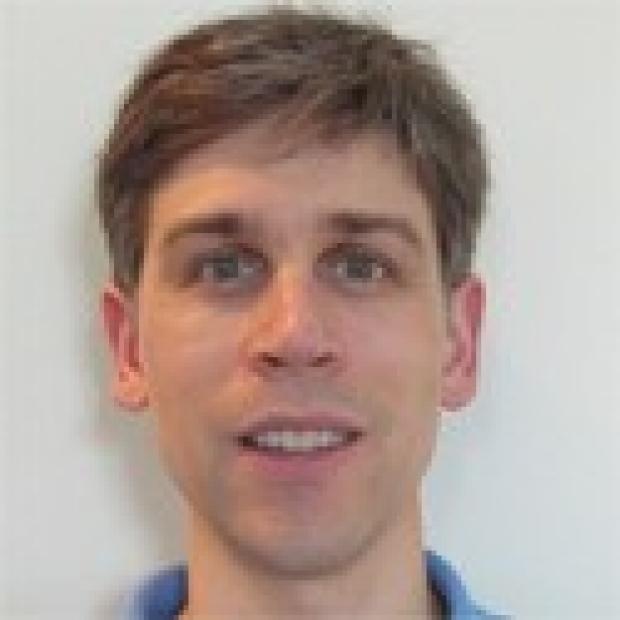 smiling headshot of Anthony Sturzu