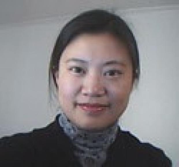 smiling headshot of Min Zeng