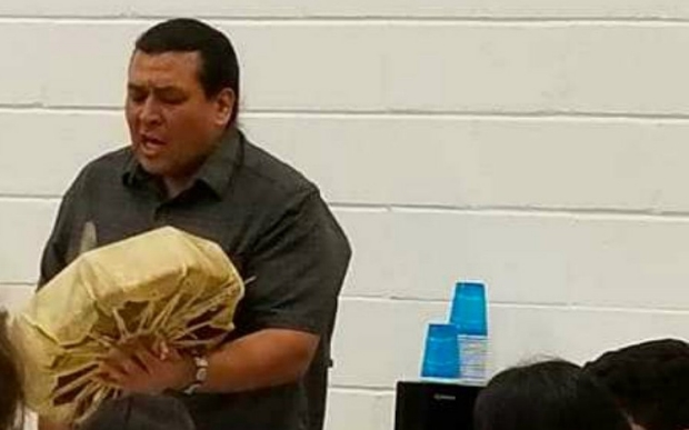 Joseph Yracheta beating a small drum