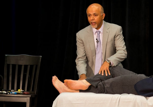 Abraham Verghese performing bedside exam