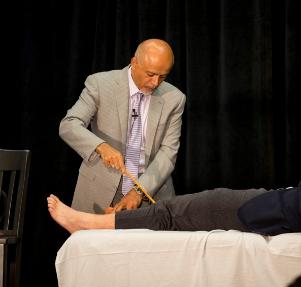 Abraham Verghese demonstrates physical exam technique