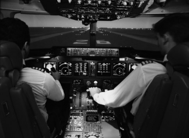 Photo of pilots in a cockpit