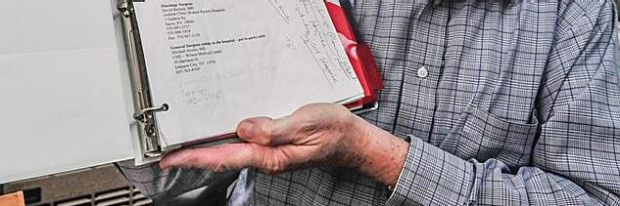 A man holds his personal notebook