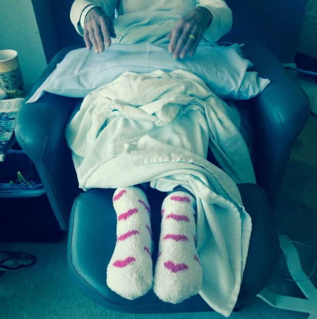 Happy Feet in the ITA - A patient waits for treatment in her happy socks