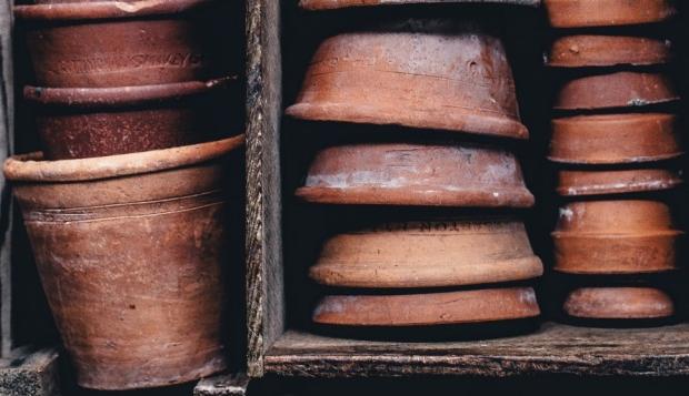 a box of old flower pots in a familiar garden