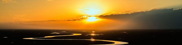 image of a river leading to a sunset