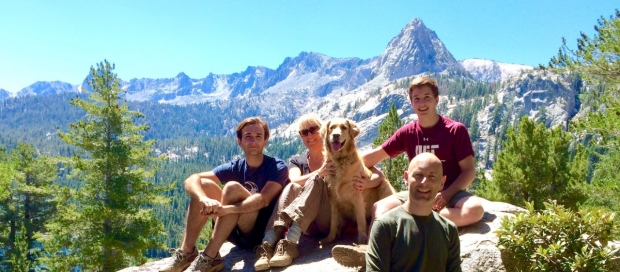 The Yoler-Lenail Family sitting on mountain