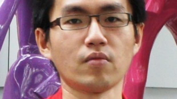 smiling headshot of Sang Ging Ong