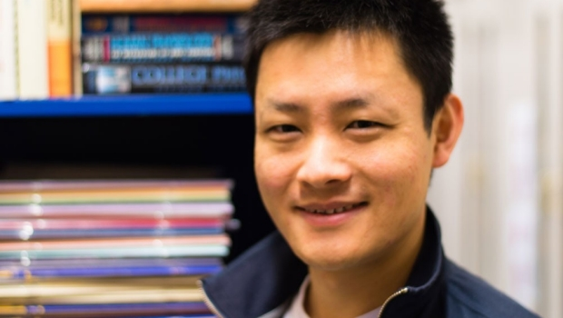 Smiling head shot of Joe Zhang