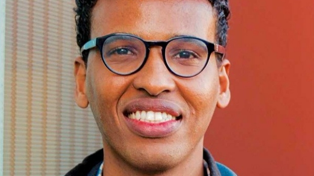 Smiling head shot of Mohamed Ameen