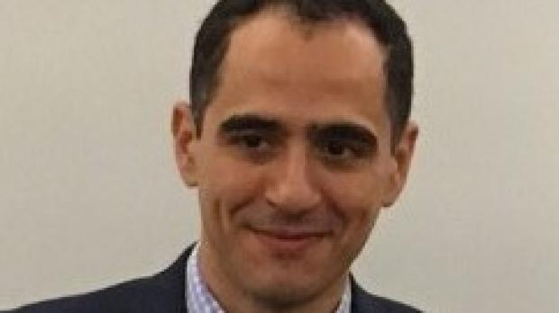 smiling headshot of Karim Sallam