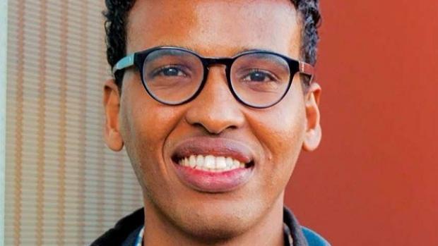 smiling headshot of Mo Ameen