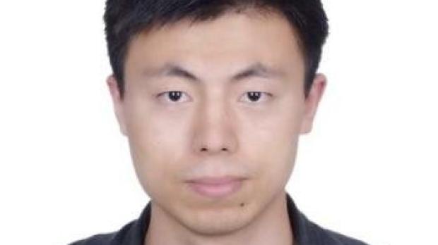 smiling headshot of Ning Ma