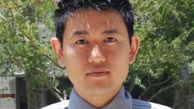 smiling headshot of Ed Lau