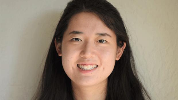 smiling headshot of Yuan Zhang