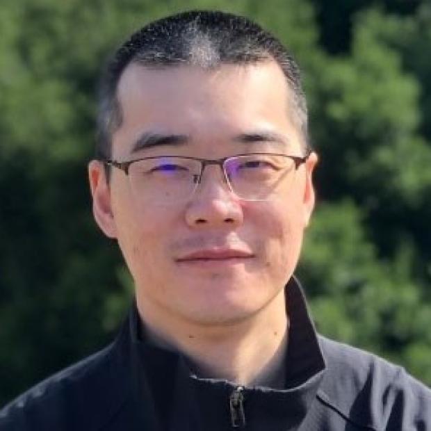 smiling headshot of Huaxiao Yang