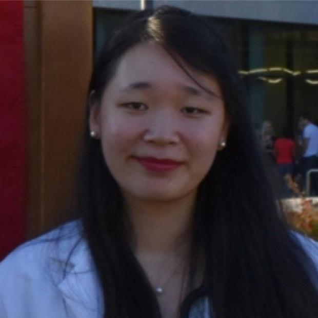 smiling headshot of Angela Zhang