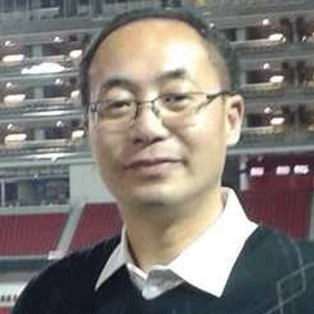 smiling headshot of Henry Zhu