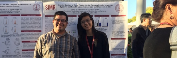 Two researchers presenting a poster