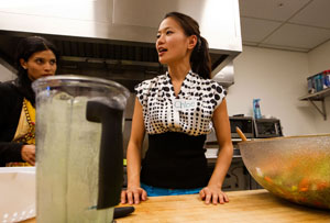 Picture of Chloe Chien, teaching a cooking class