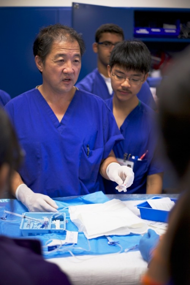 Paul Chang teaching students in surgery lab