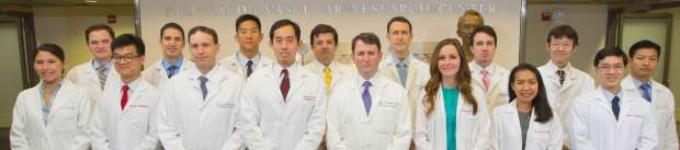 group picture of residents and Drs. Michael Fischbein and Joseph Woo all wearing lab coats