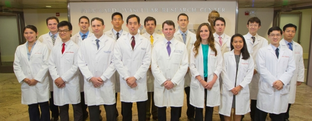 group shot of Stanford Cardiothoracic Surgery Residents and faculty in white lab coats